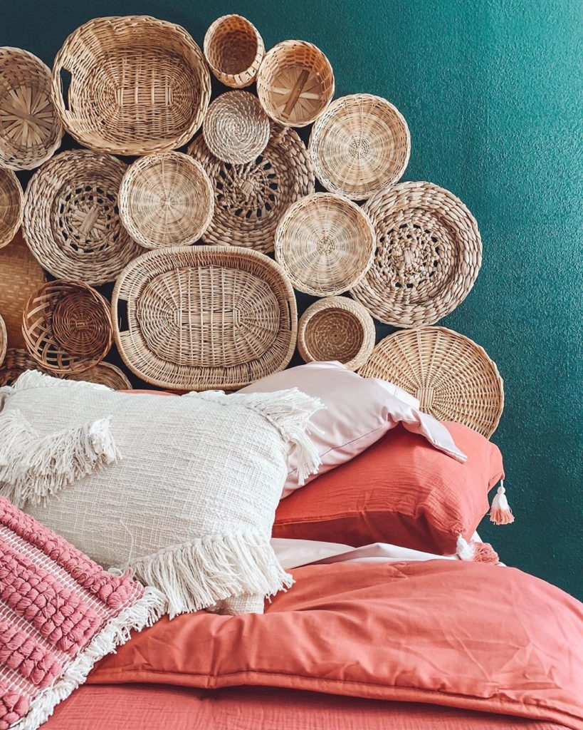 A lot of can baskets on the wall as wall decor.