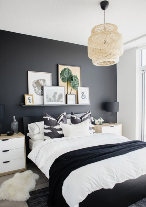 Black painted wall in the bedroom.