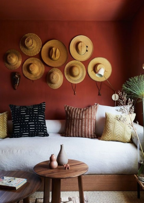 Brown painted walls with hats on it as wall decor.