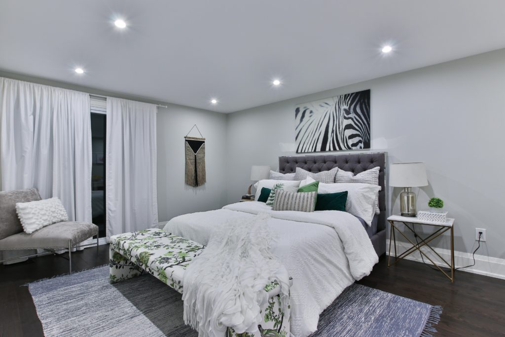 White bedroom with general light in the ceiling