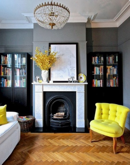 Grey painted walls with fire place.