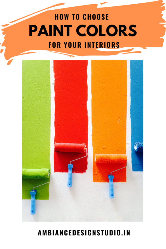 Green, red, orange and blue paint tested with roller on a wall