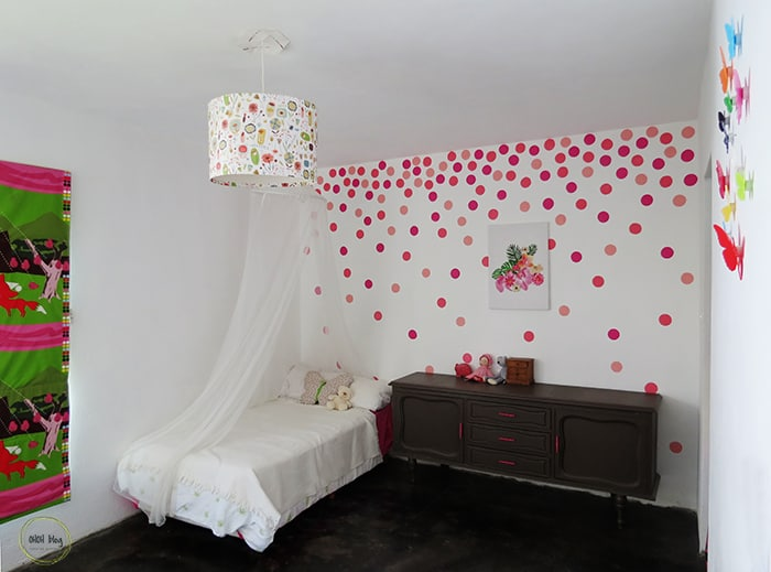 pink DIY polka dots on a white wall.
