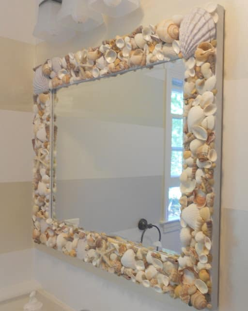 Mirror with sea shells as its frame