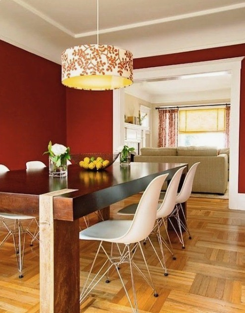 Red painted walls in the dining room with white ceiling.