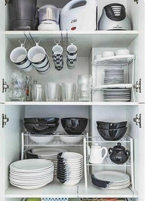 Serving bowls on racks for a organized kitchen