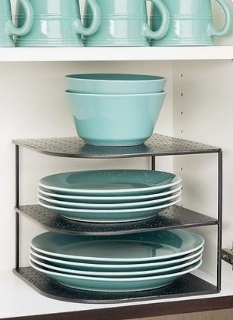 Plates on metal rack for better kitchen organization