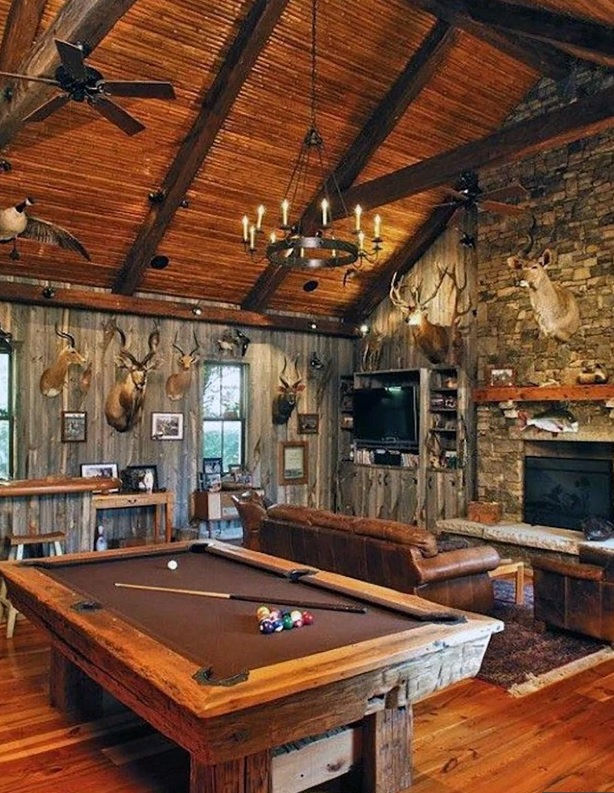 Man cave with pool table and fire place