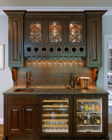 Traditional wooden bar with sink and mini fridge