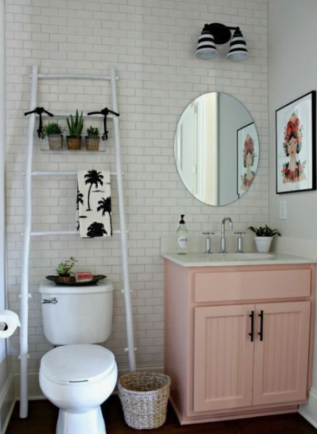 Ladder storage above western commode in bathroom