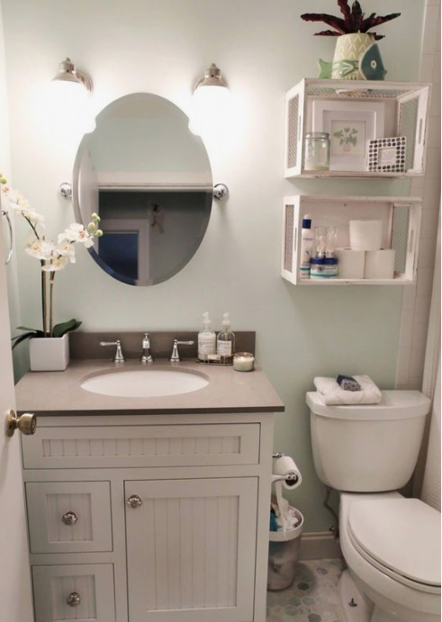 Box type storage above western commode in bathroom