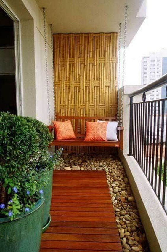 Zen balcony with pebbles and swing and bamboo