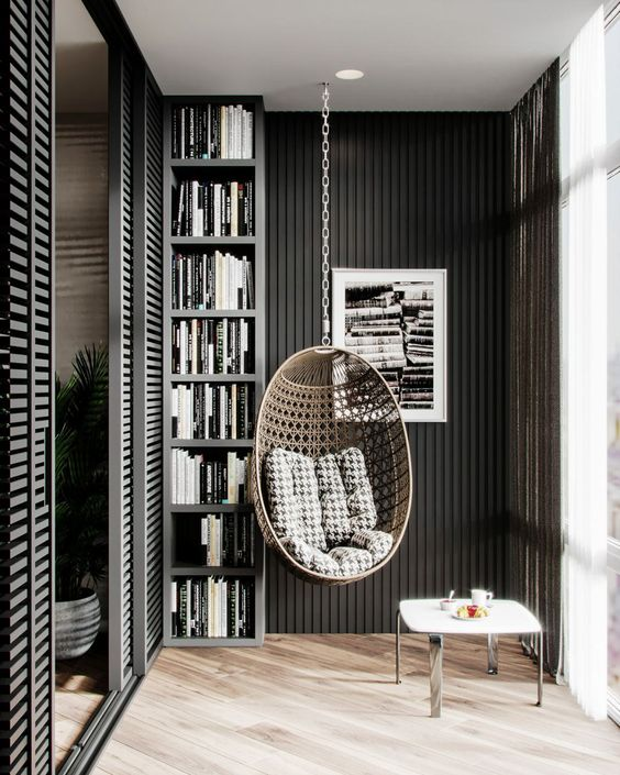 Balcony with a book rack and hanging cane chair
