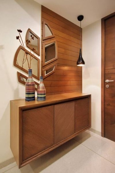 Wooden cabinets with wall panel and mirror