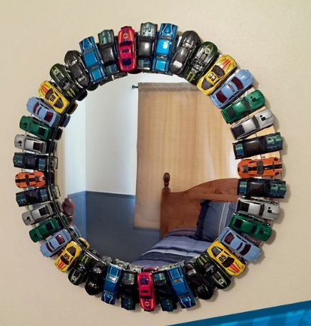 Mirror decorated with toy cars around it